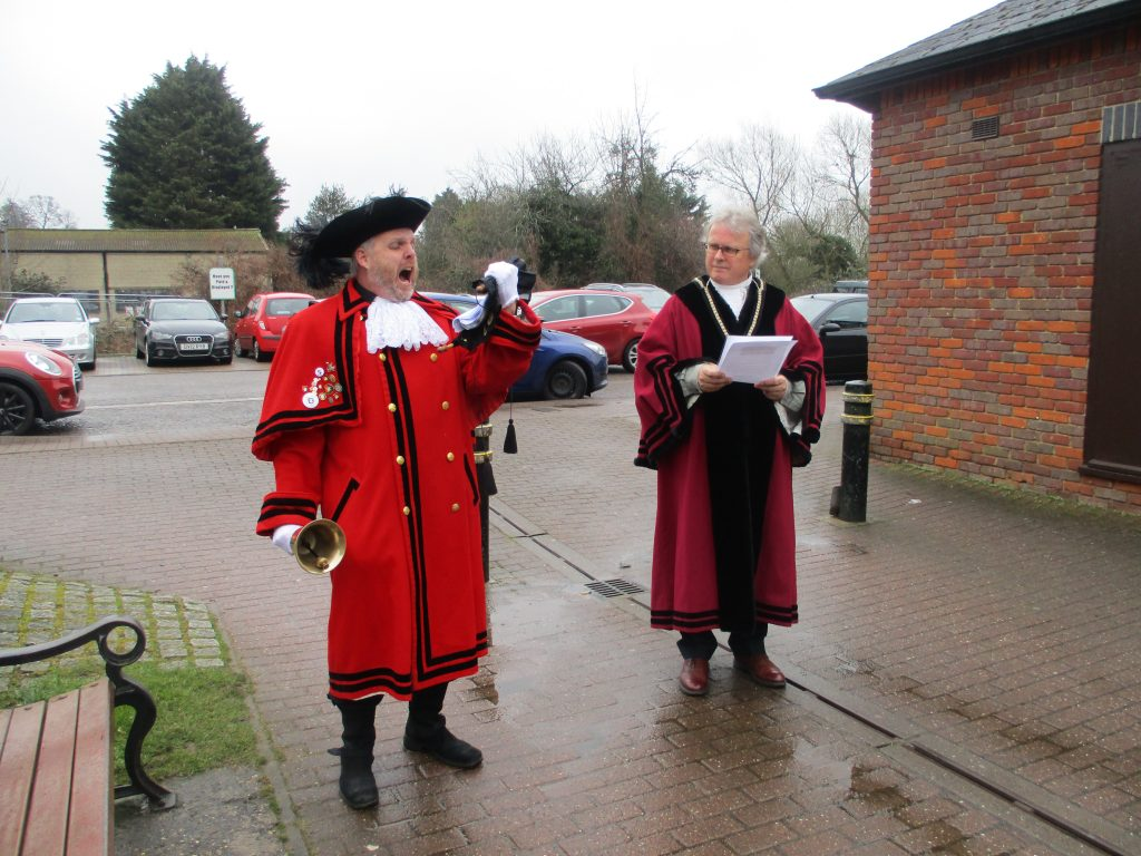 The Mayor and Town Crier raising the commonwealth flag
