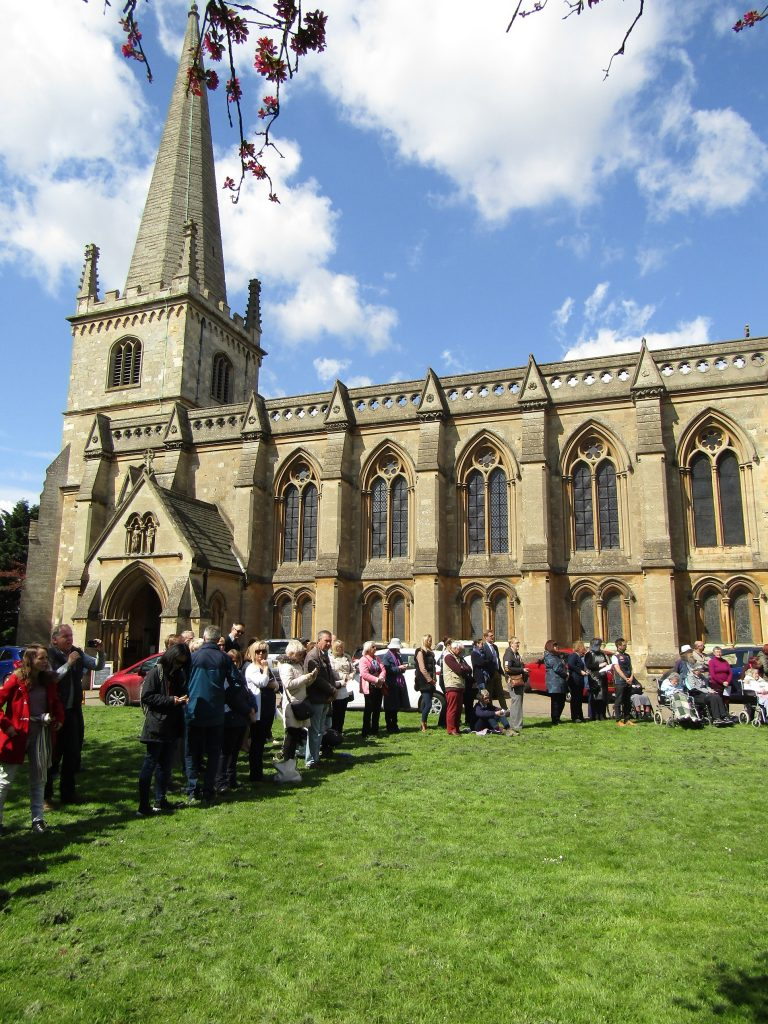 crowds outside the Church watching may pole dancing