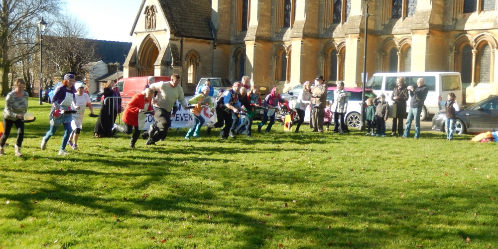 Racers competing at the pancake race