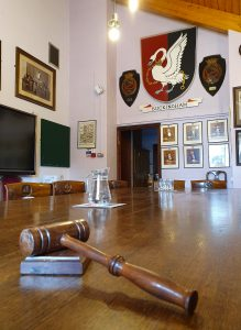 Council Chamber showing the gavel, town council logo and screen