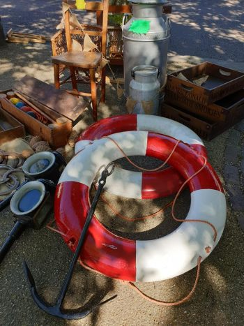 life rings, milk urn, chairs and more at the flea market