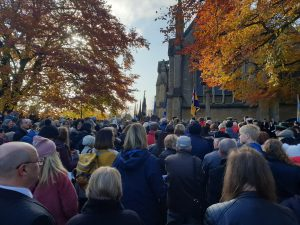 crowds gather by the War Memorial for the service