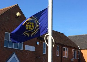 Councillors raising the Commonwealth Flag at the flagpole