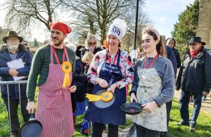 The library team of runners at the pancake race