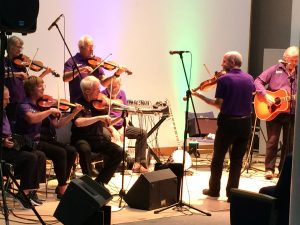 Image showing memberso of the Oxford Fiddle Group playing fiddles and guitar
