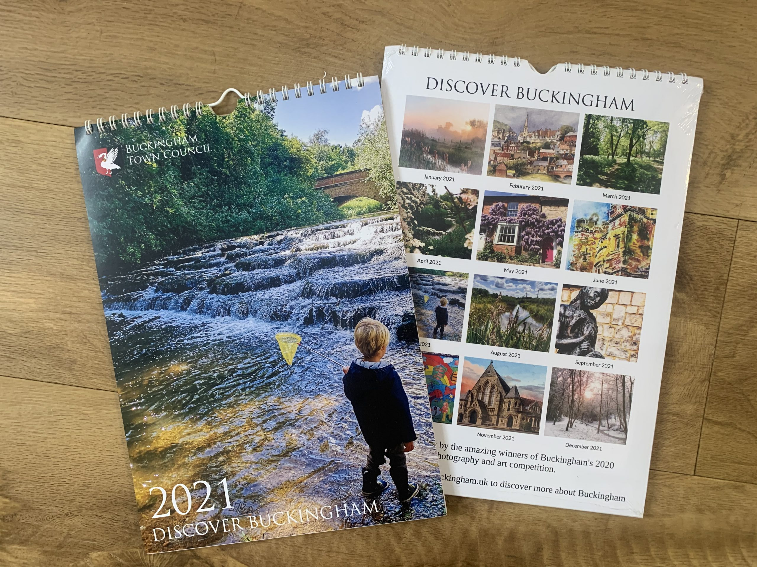 Front and Back covers of the Buckingham 2021 calendar. The front image shows a child with a fishing net standing in the Flosh
